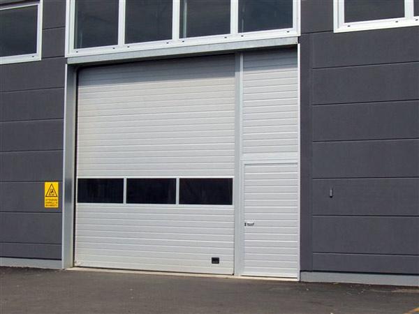 Portone sezionale carpi correggio serrande porte garage for Aggiungendo spazio sopra il costo del garage
